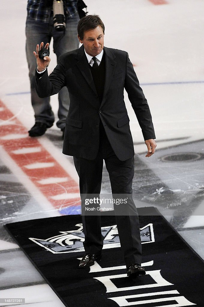 Wayne Gretzky waves to the crowd after dropping the ceremonial puck prior to the game between the Los Angeles Kings and the New Jersey Devils in Game Three of the 2012 Stanley Cup Final at Staples Center on June 4, 2012 in Los Angeles, California.