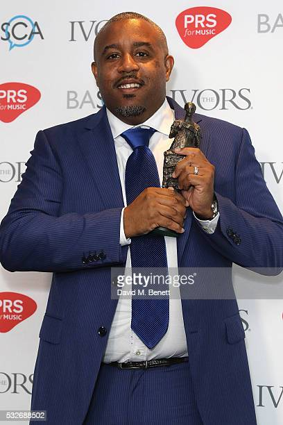 Wayne Hector poses after winning the award for International Achievement in the winners room during the Ivor Novello Awards 2016 at The Grosvenor...
