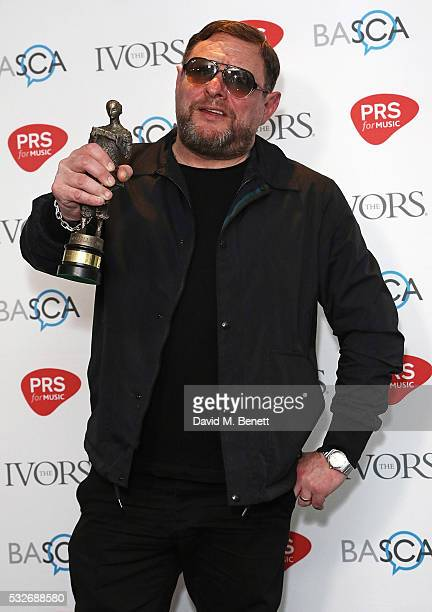 Wayne Hector poses after winning the award for The Ivors Inspiration Award in the winners room during the Ivor Novello Awards 2016 at The Grosvenor...