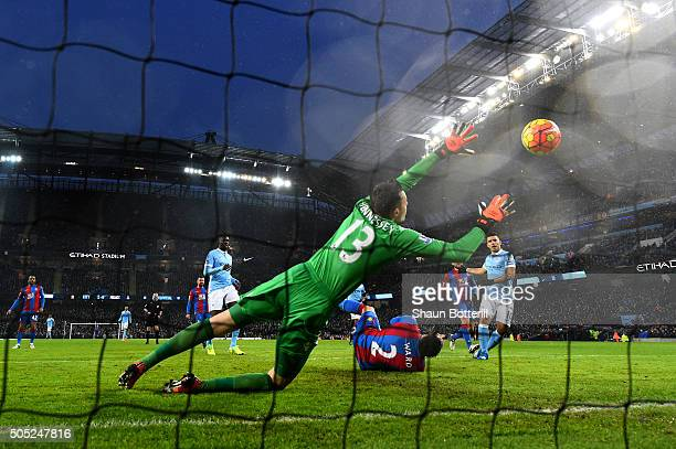 Wayne Hennessey of Crystal Palace dives in vain as Sergio Aguero of Manchester City scores during the Barclays Premier League match between...