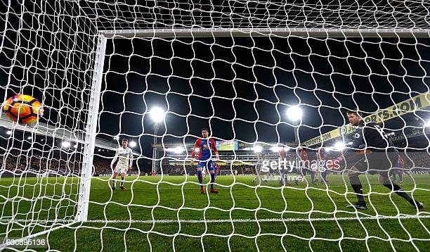 Wayne Hennessey of Crystal Palace watches the ball as Alfie Mawson of Swansea City scores the opening goal during the Premier League match between...