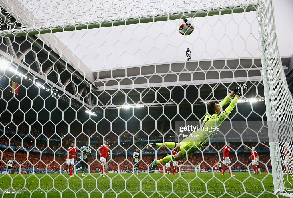 <a gi-track='captionPersonalityLinkClicked' href=/galleries/search?phrase=Wayne+Hennessey&family=editorial&specificpeople=4304710 ng-click='$event.stopPropagation()'>Wayne Hennessey</a> of Wales dives in vain as Radja Nainggolan (not pictured) of Belgium scores the opening goal during the UEFA EURO 2016 quarter final match between Wales and Belgium at Stade Pierre-Mauroy on July 1, 2016 in Lille, France.
