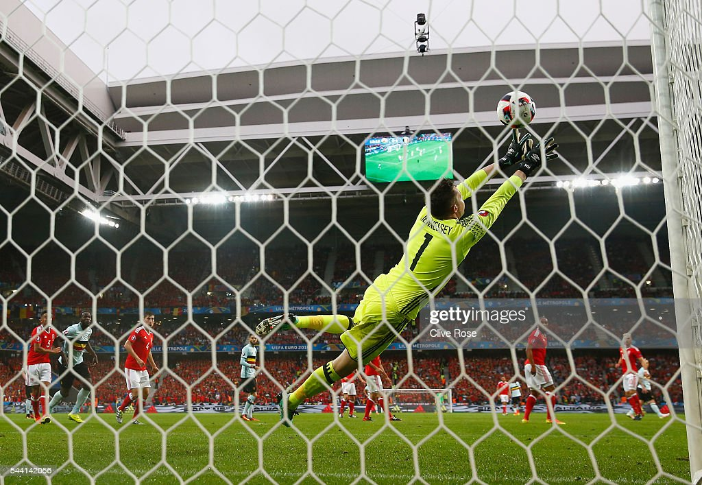 <a gi-track='captionPersonalityLinkClicked' href=/galleries/search?phrase=Wayne+Hennessey&family=editorial&specificpeople=4304710 ng-click='$event.stopPropagation()'>Wayne Hennessey</a> of Wales dives in vain as Radja Nainggolan of Belgium scores the opening goal during the UEFA EURO 2016 quarter final match between Wales and Belgium at Stade Pierre-Mauroy on July 1, 2016 in Lille, France.