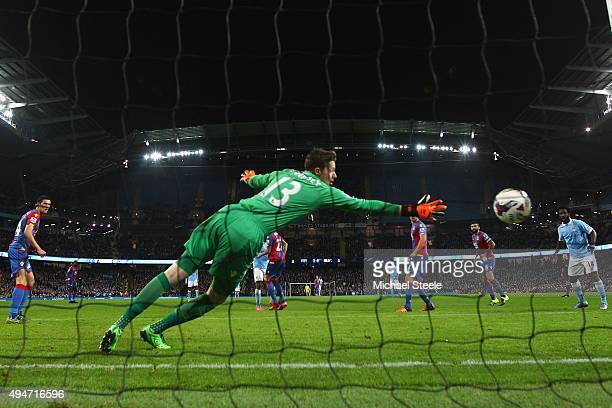 Wayne Hennessey the goalkeeper of Crystal Palace is beaten by a shot from Kelechi Iheancho of Manchester City conceding his sides third goal during...