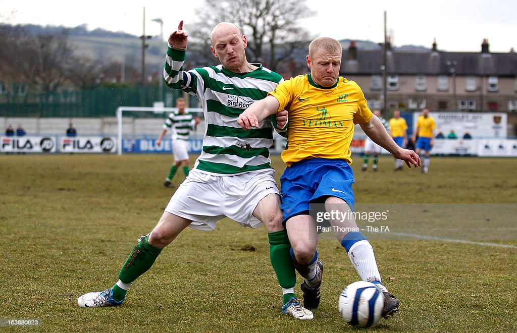 Wayne Hudson (R) of HT Sports in action with Leighton McGivern of Oyster Martyrs during The FA Sunday Cup Semi Final match between HT Sports v Oyster Martyrs at Nethermoor Park on March 17, 2013 in Guiseley, England.