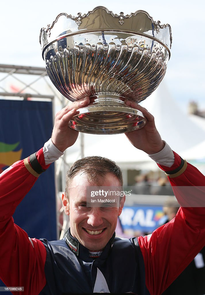 Wayne Hutchinson poses with his trophy after he wins The Coral Scottish Grand National Handicap Steeple Chase on Godsmejudge at Ayr racecourse on April 20, 2013 in Ayr, Scotland.