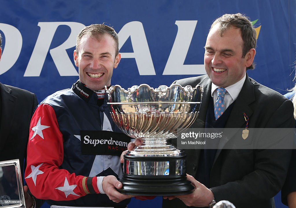 Wayne Hutchinson posses with his trophy with trainer Alan King after he wins The Coral Scottish Grand National Handicap Steeple Chase riding Godsmejudge, at Ayr racecourse on April 20, 2013 in Ayr, Scotland.