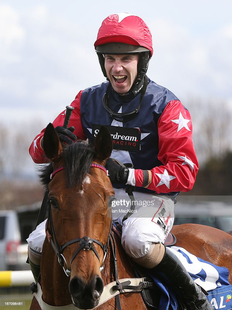 Wayne Hutchinson riding Godsmejudge celebrates winning the The Coral Scottish Grand National Handicap Steeple Chase at Ayr Racecourse on April 20, 2013 in Ayr, Scotland.