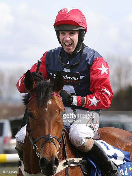 Wayne Hutchinson riding Godsmejudge celebrates winning the The Coral Scottish Grand National Handicap Steeple Chase at Ayr Racecourse on April 20...