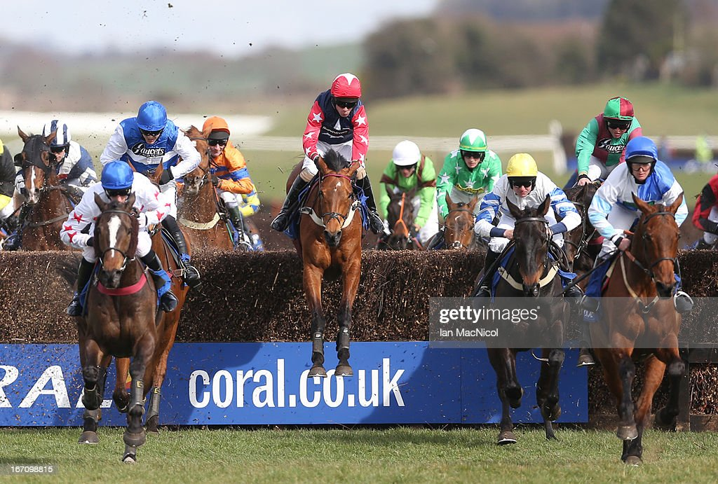 Wayne Hutchinson (red sleeves and white stars) riding Godsmejudge wins The Coral Scottish Grand National Handicap Steeple Chase at Ayr racecourse on April 20, 2013 in Ayr, Scotland.
