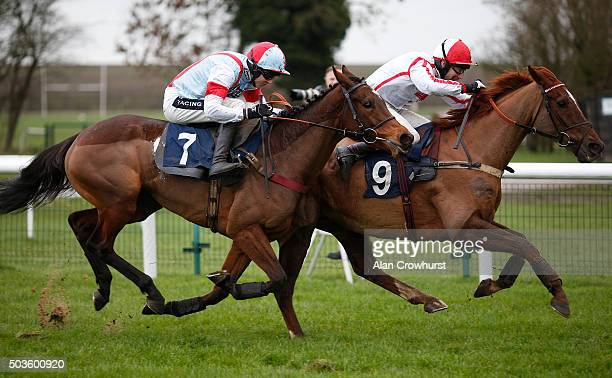 Wayne Hutchinson riding Kings Bayonet clear the last to win The rewards4racingcom Handicap Hurdle Race from Tara Flow at Huntingdon racecourse on...