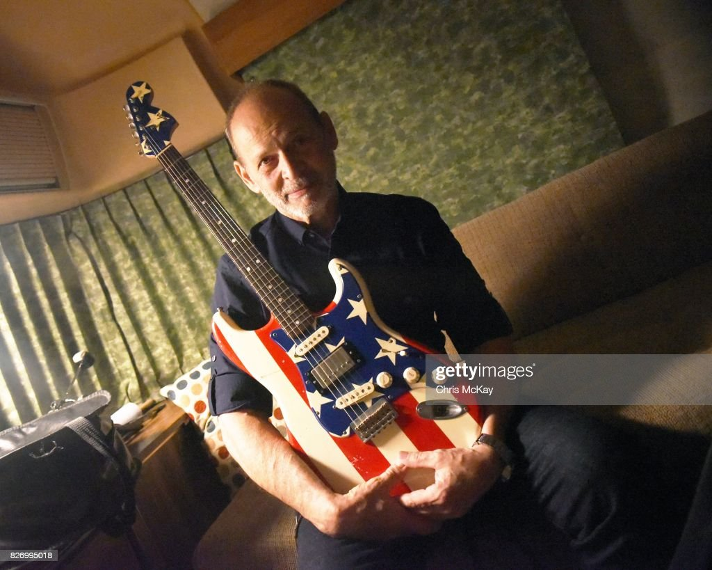 Wayne Kramer (from the MC5) waits backstage with his famous American Flag Fender Stratocaster for his performance at the Artist2Artist Benefit For Homeless Veterans at The Office on August 5, 2017 in Athens, Georgia.