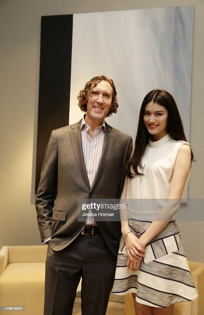 Wayne Kulkin, CEO of Stewart Weitzman with model He Sui at pre-cocktail drinks for the opening of the Stuart Weitzman Boutique designed by Zaha Hadid in Hong Kong, March 21, 2014.