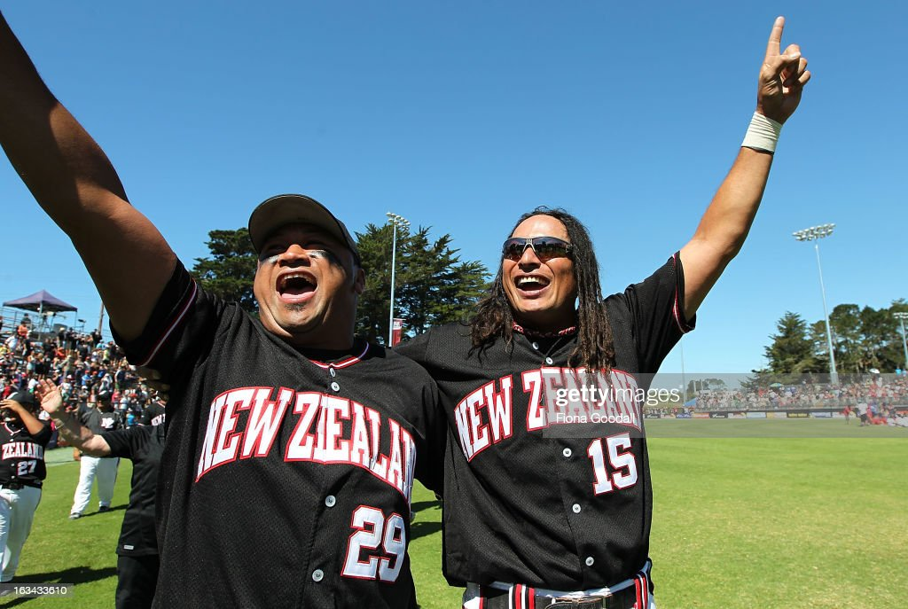 Wayne Laulu and Brad Rona thank the crowd and celebrate the Black Sox winning the Softball World Championship over Venezuela at Tradstaff Sports Stadium on March 10, 2013 in Auckland, New Zealand.