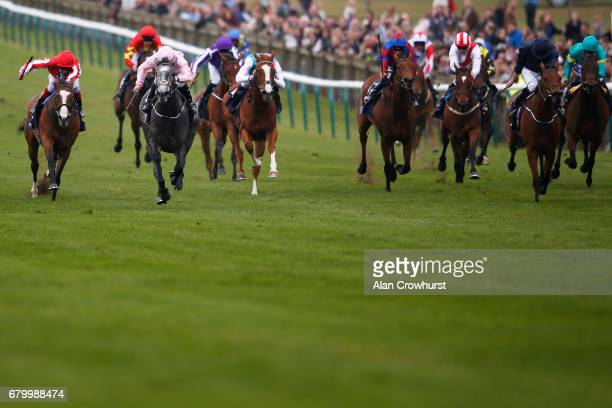 Wayne Lordon riding Winter win The Qipco 1000 Guineas Stakes from Rhododendron and Daban at Newmarket Racecourse on May 7 2017 in Newmarket England