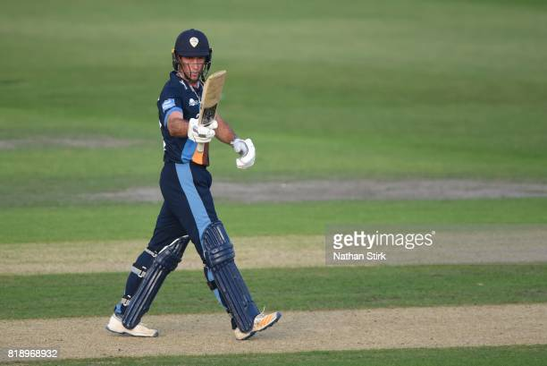 Wayne Madsen of Derbyshire Falcons raises his bat after scoring 50 runs during the NatWest T20 Blast match between Worcestershire Rapids and...