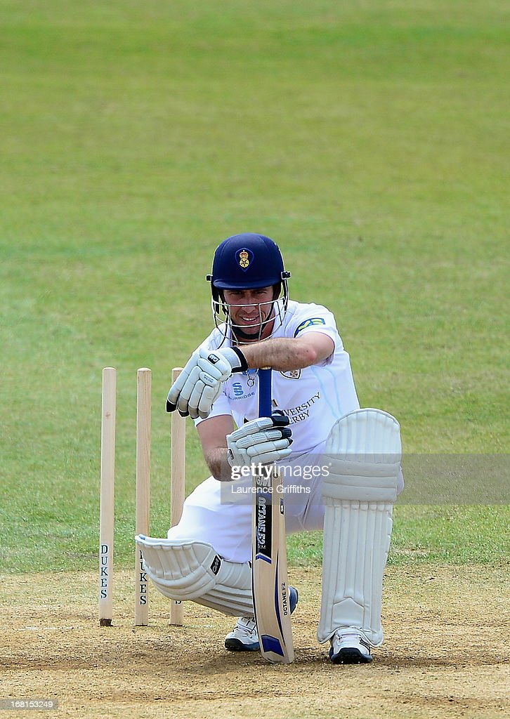 Wayne Madsen of Derbyshire slumps on his bat after being bowled by Bruce Martin of New Zealand during the Tour match between Derbyshire and New Zealand at The County Ground on May 6, 2013 in Derby, England.