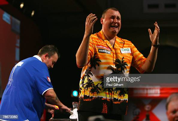 Wayne Mardle of England celebrates winning the quarter final match between Phil Taylor of England and Wayne Mardle of England as Phil Taylor looks on...