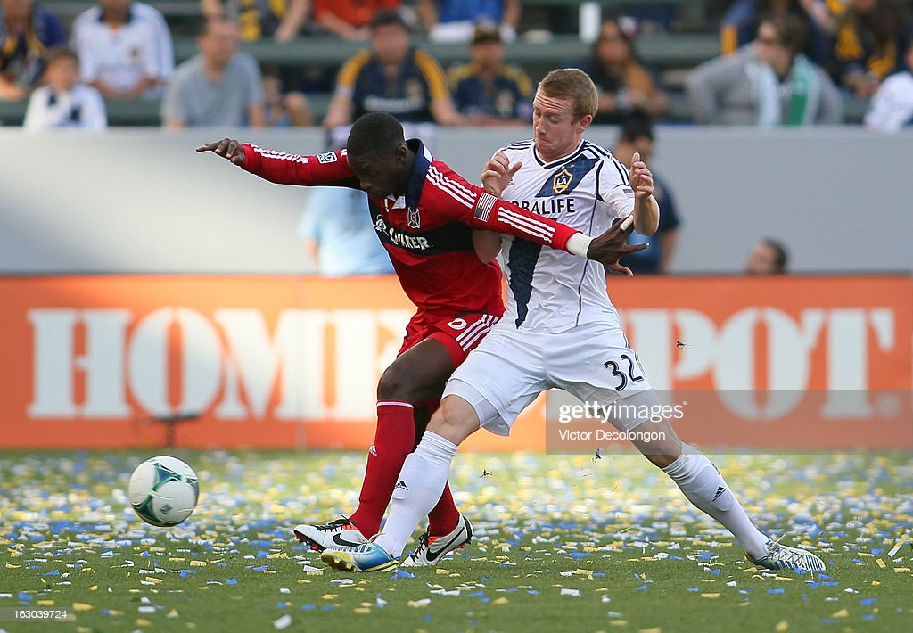 Wayne McBean #32 of the Los Angeles Galaxy and Jalil Anibaba #6 of the Chicago Fire vie for the ball during the MLS match at The Home Depot Center on March 3, 2013 in Carson, California. The Galaxy defeated the Fire 4-0.