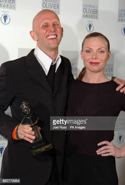 Wayne McGregor poses with the Best New Design Production Award presented by Samantha Janus at the 2007 Laurence Olivier awards at the Grosvenor House...