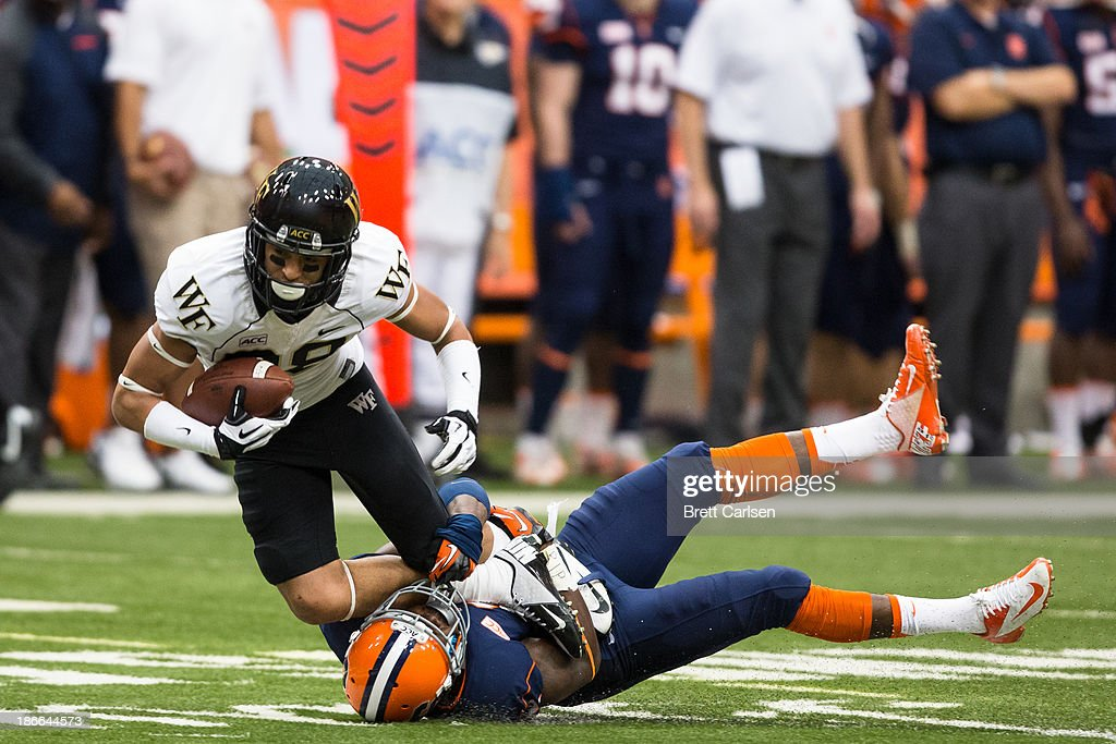 Wayne Morgan #2 of Syracuse Orange brings down Jared Crump #88 of Wake Forest Demon Deacons following a 15 yard first down reception in the third quarter on November 2, 2013 at the Carrier Dome in Syracuse, New York. Syracuse shuts out Wake Forest 13-0