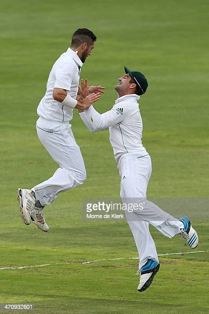 Wayne Parnell and Dean Elgar of South Africa celebrate after Parnell got the wicket of Shaun Marsh of Australia during day two of the Second Test...