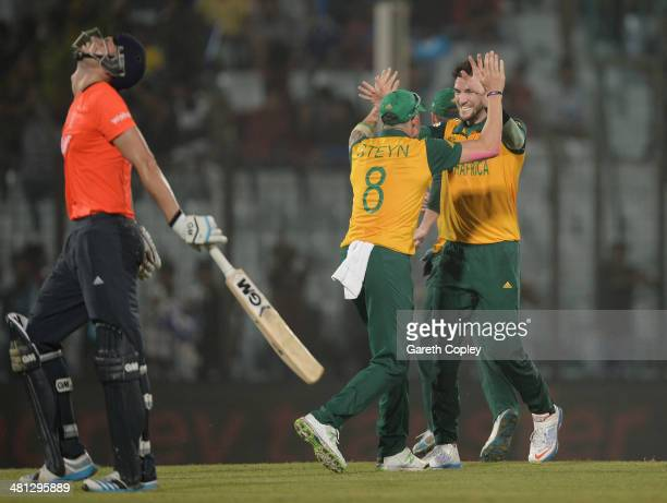 Wayne Parnell of South Africa celebrates with Dale Steyn after dismissing Alex Hales of England during the ICC World Twenty20 Bangladesh 2014 Group 1...