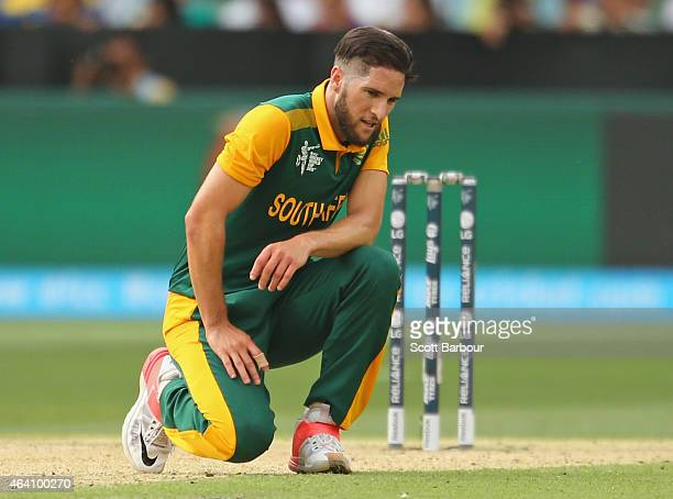 Wayne Parnell of South Africa reacts after being hit for a boundary during the 2015 ICC Cricket World Cup match between South Africa and India at...