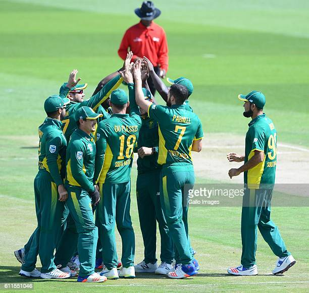 Wayne Parnell of the Proteas celebrates the wickets of David Warner of Australia with his team mates during the 1st Momentum ODI Series match between...