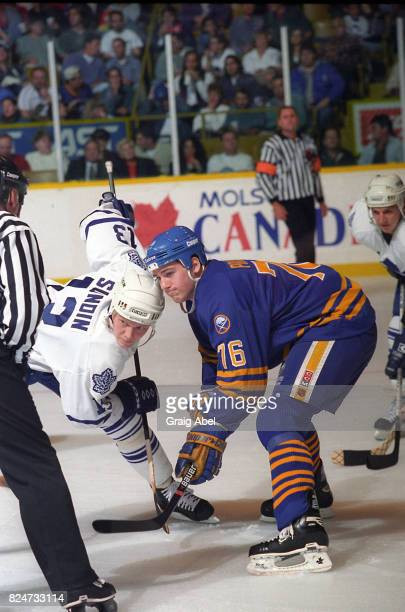 Wayne Primeau of the Buffalo Sabres prepares for a faceoff against Matts Sundin of the Toronto Maple Leafs during NHL preseason action on October 2...