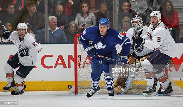 Wayne Primeau of the Toronto Maple Leafs chases after the puck in a game against the Edmonton Oilers on March 13 2010 at the Air Canada Centre in...
