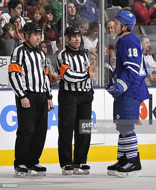 Wayne Primeau of the Toronto Maple Leafs talks with referees Marc Joanette and Justin St Pierre during a break in the game against the Montreal...