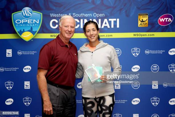 J Wayne Richmond presents Garbine Muguruza of Spain with a special gift from the USTA after her win over Simona Halep of Romania during the women's...