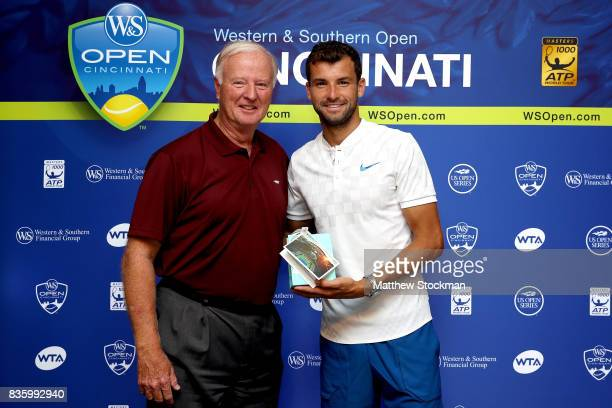 J Wayne Richmond presents Grigor Dimitrov of Bulgaria a special gift from the USTA after his win over Nick Kyrgios of Australia during the men's...