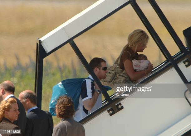 Wayne Rooney and Alex Curran during England Football Players Wives and Girlfriends Leave to Return to England after the FIFA 2006 World Cup at...
