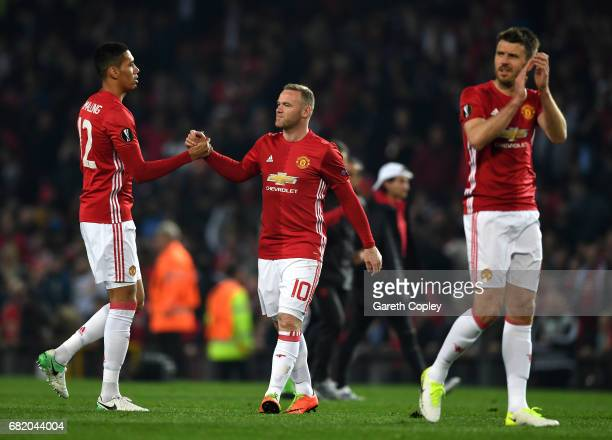 Wayne Rooney and Chris Smalling of Manchester United speak following the UEFA Europa League semi final second leg match between Manchester United and...