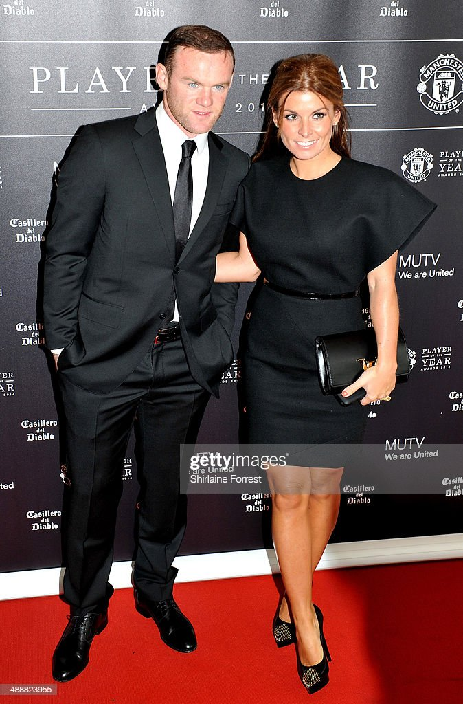 <a gi-track='captionPersonalityLinkClicked' href=/galleries/search?phrase=Wayne+Rooney&family=editorial&specificpeople=157598 ng-click='$event.stopPropagation()'>Wayne Rooney</a> and Coleen Rooney attend the Manchester United Player of the Year awards at Old Trafford on May 8, 2014 in Manchester, England.