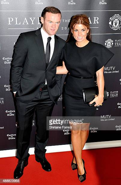 Wayne Rooney and Coleen Rooney attend the Manchester United Player of the Year awards at Old Trafford on May 8 2014 in Manchester England