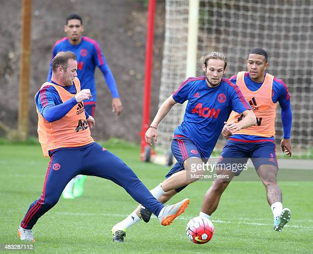 Wayne Rooney and Daley Blind of Manchester United in action during a first team training session at Aon Training Complex on August 5 2015 in...