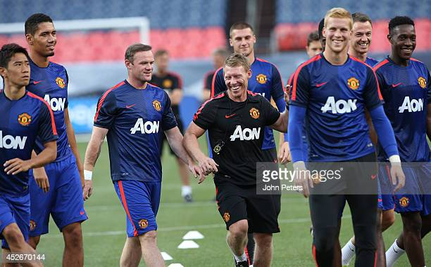 Wayne Rooney and Fitness Coach Gary Walker of Manchester United in action during a training session as part of their preseason tour of the United...