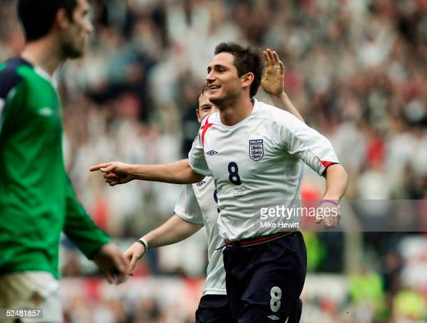 Wayne Rooney and Frank Lampard celebrate Lampard's goal and his teams fourth during the World Cup Qualifier Group 6 match between England and...