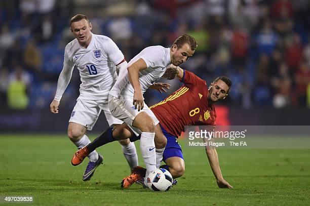 Wayne Rooney and Harry Kane of England in action with Koke of Spain during the international friendly match between Spain and England at the Estadio...