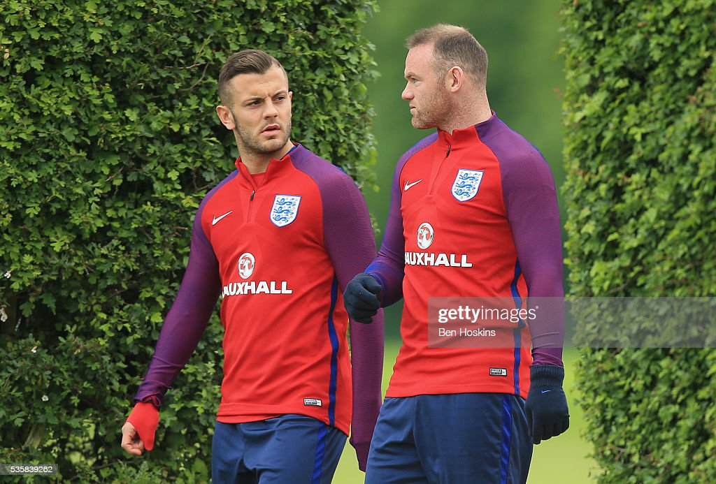<a gi-track='captionPersonalityLinkClicked' href=/galleries/search?phrase=Wayne+Rooney&family=editorial&specificpeople=157598 ng-click='$event.stopPropagation()'>Wayne Rooney</a> and <a gi-track='captionPersonalityLinkClicked' href=/galleries/search?phrase=Jack+Wilshere&family=editorial&specificpeople=5446655 ng-click='$event.stopPropagation()'>Jack Wilshere</a> of England in conversation during an England training session at St Georges Park on May 30, 2016 in Burton on Trent, England.