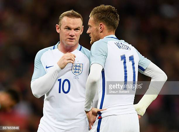 Wayne Rooney and Jamie Vardy of England speak during the international friendly match between England and Portugal at Wembley Stadium on June 2 2016...