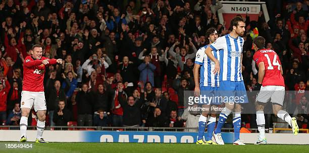 Wayne Rooney and Javier 'Chicharito' Hernandez of Manchester United celebrate Carlos Martinez of Real Sociedad scoring an owngoal during the UEFA...