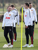 Wayne Rooney and Jonny Evans of Manchester United in action during a first team training session at Aon Training Complex on February 27 2015 in...