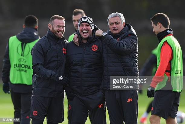 Wayne Rooney and Jose Mourinho manager of Manchester United joke with the team sports therapist Rod Thornley during a Manchester United training...
