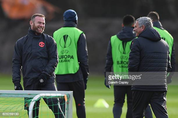 Wayne Rooney and Jose Mourinho manager of Manchester United smile during a Manchester United training session on the eve of their UEFA Europa League...