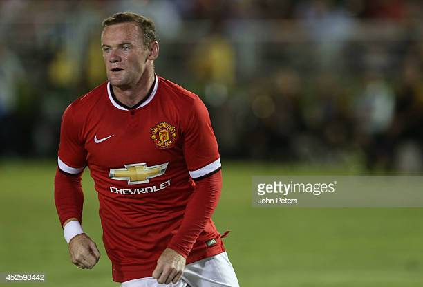 Wayne Rooney and Juan Mata of Manchester United in action during the preseason friendly match between LA Galaxy and Manchester United at Rose Bowl on...