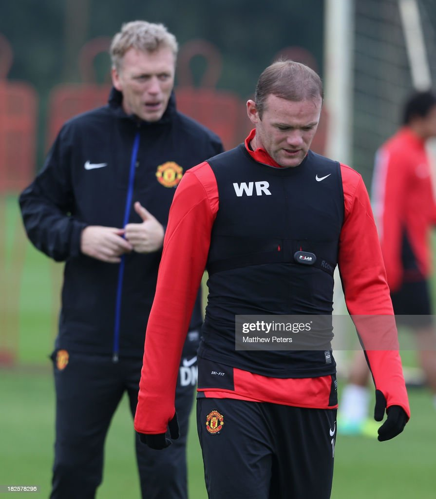 Wayne Rooney and Manager David Moyes of Manchester United in action during a first team training session, ahead of their UEFA Champions League match against Shaktar Donetsk, at Aon Training Complex on October 1, 2013 in Manchester, England.